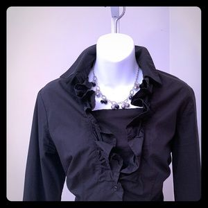 Black button down blouse with ruffle detail